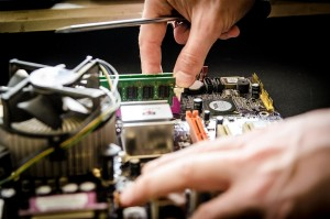 Hands With Computer Hardware